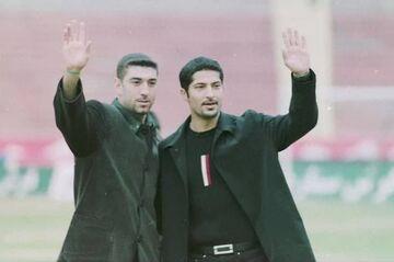 عکس| گلباران مزار مهرداد میناوند و علی انصاریان توسط هواداران