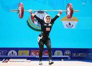 عکس روز| اولین دختر ایرانی در مسابقات جهانی وزنهبرداری
